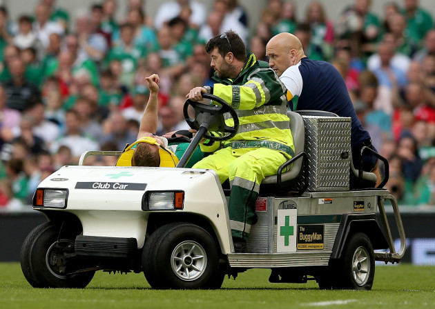 Keith Earls signals to the crowd as he is replaced