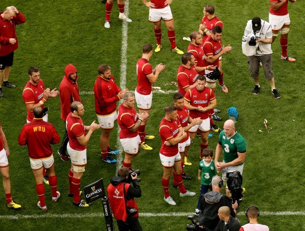 Welsh players applaud off Paul O'Connell with his son Paddy after the game