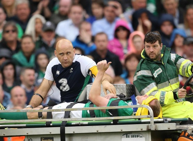 Keith Earls signals to the crowd as he goes off injured