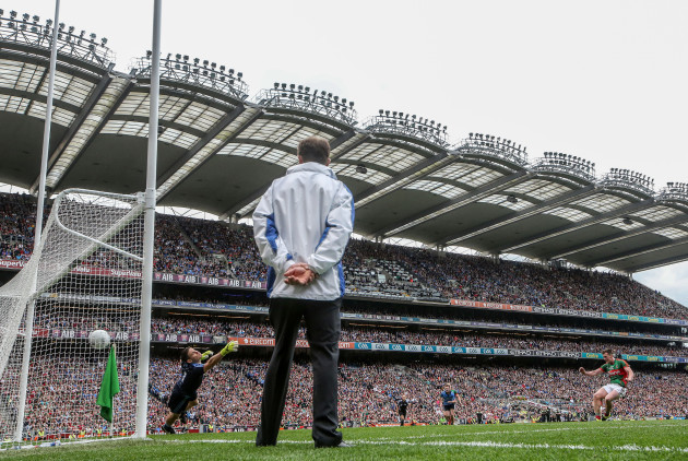 Cillian O'Connor scores a late penalty past goalkeeper Stephen Cluxton