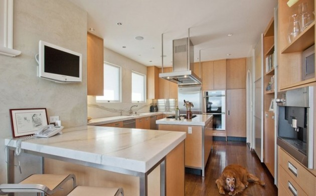 the-kitchen-is-spacious-and-comes-with-all-of-the-necessary-built-in-appliances-though-we-dont-think-the-dog-is-included-in-the-deal