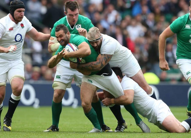 Dave Kearney is tackled by Joe Marler and Ben Youngs