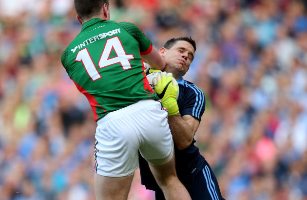 Cillian OÕConnor collides with goalkeeper Stephen Cluxton