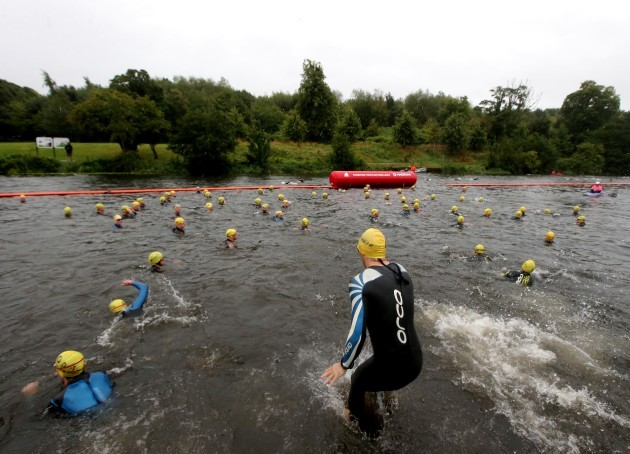 Competitors enter the Liffey