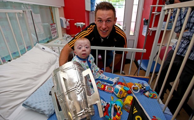 Cillian Buckley and Conor Travers with The Liam McCarthy Cup