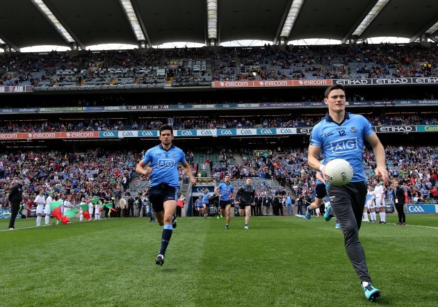 Cian O'Sullivan and Diarmuid Connolly make their way out