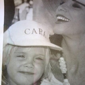#ThrowbackThursday guess who that little girl on my lap is? Sending masses of love @caradelevingne