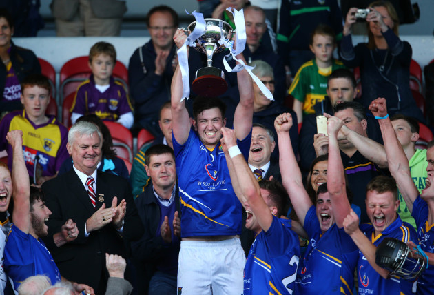 Gavin Weir lifts the cup