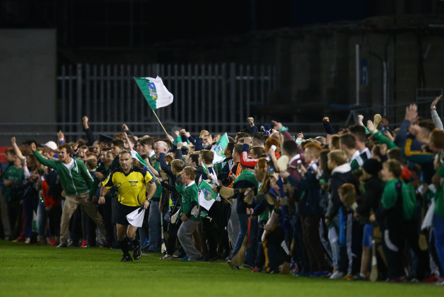 Limerick supporters prepare to invade the pitch