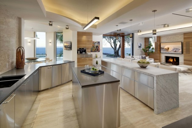 the-kitchen-is-filled-with-stainless-steel-appliances