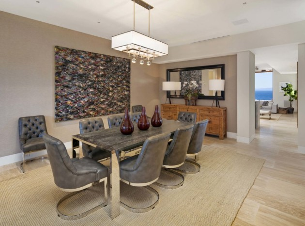a-formal-dining-room-offers-plenty-of-space-for-guests-and-shares-an-aquarium-wall-with-the-living-room-the-aquariums-water-changes-are-also-automated
