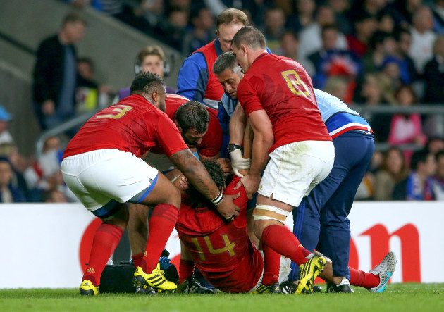 Yoann Huget his helped up by Mathieu Bastareaud, Yoann Maestri  and Louis Picamoles after he got injured