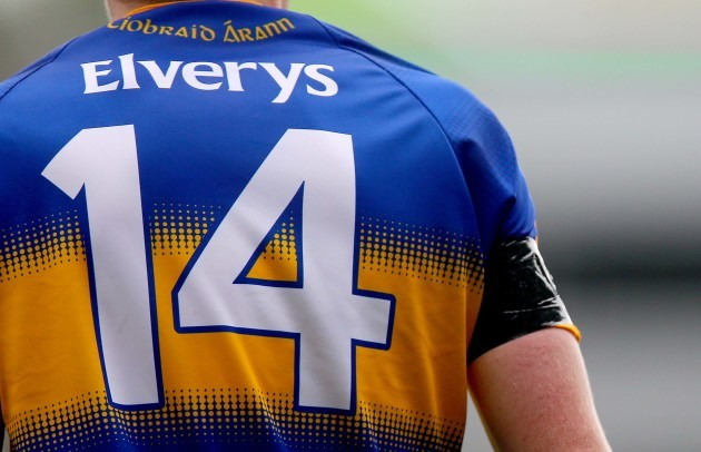 Tipperary players wear black arm bands in memory of Ediie Connolly who died during the week
