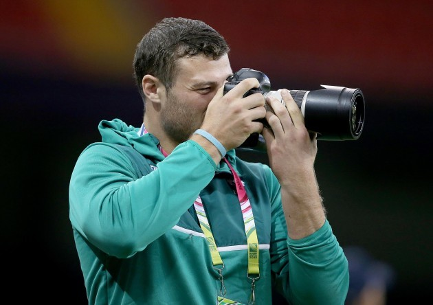 Robbie Henshaw takes pictures of the Irish squad training