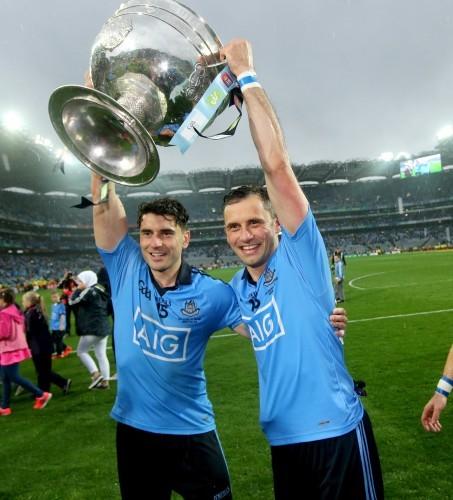 Bernard Brogan and Alan Brogan celebrate with the Sam Maguire trophy