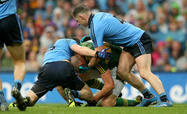 Rory O'Carroll and Philly McMahon tackle Kieran Donaghy