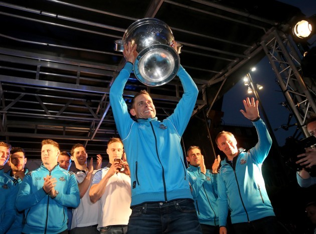 Stephen Cluxton arrives with the Sam Maguire Trophy