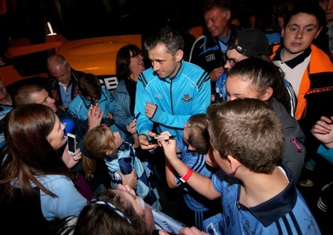 Alan Brogan signs autographs for fans