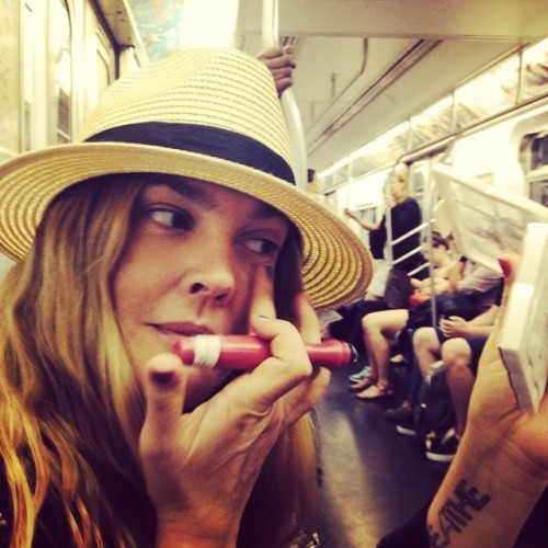 Concealing on the subway! With a @flowerbeauty tester roller ball concealer that comes out January 2015 @walmart #commuterbeauty