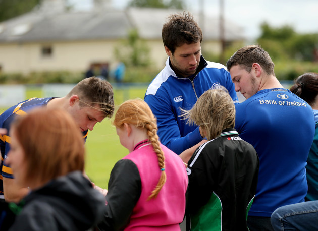 Kevin McLaughlin signs autographs after training