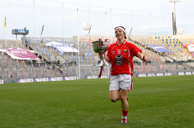 Valerie Mulcahy celebrates with the trophy