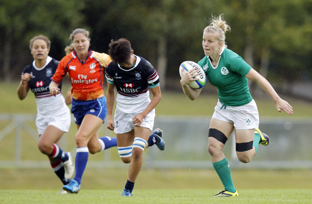 Claire Molloy runs in for a try