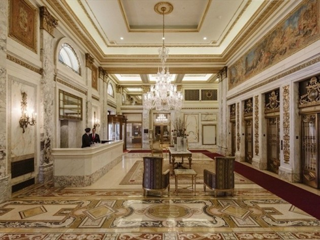 a-gorgeous-lobby-is-just-one-of-the-buildings-amenities-residents-get-all-of-the-benefits-of-living-in-a-hotel-like-cleaning-services-and-access-to-the-spa-fitness-center-hair-salon-and-ballroom