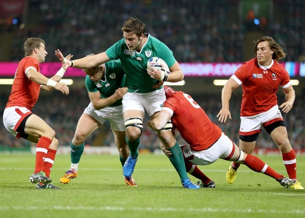 Iain Henderson tackled by Kyle Gilmour