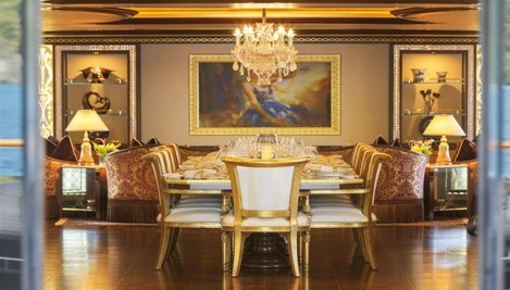 every-aspect-of-the-vessel-is-beautifully-maintained-right-down-to-the-chandelier-that-hangs-over-one-of-the-many-dining-tables-that-can-seat-up-to-12-on-the-far-wall-is-a-painting-an-unusual-fixture-on-any-y