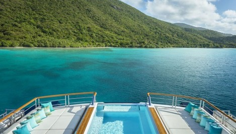 the-view-from-the-highest-point-on-the-boat--the-master-suite--looking-off-the-stern-onto-the-clear-blue-sea-of-whichever-exotic-location-the-solandge-has-sailed-to