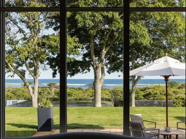 sitting-on-over-nine-acres-of-land-at-120-feet-above-the-atlantic-the-home-affords-bountiful-ocean-views-of-the-south-shore-and-chilmark-pond