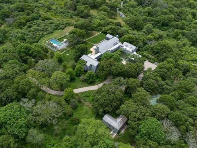 a-private-driveway-leads-to-the-estate-which-includes-a-half-basketball-court-and-a-dock-and-access-to-three-private-beaches