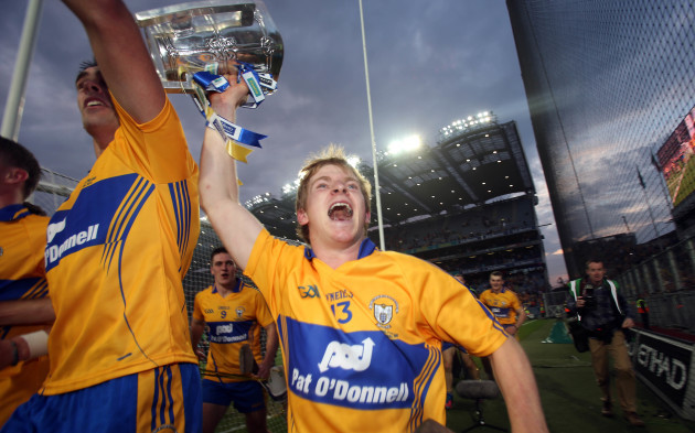 Padraic Collins celebrates with The Liam McCarthy Cup in front of Hill 16