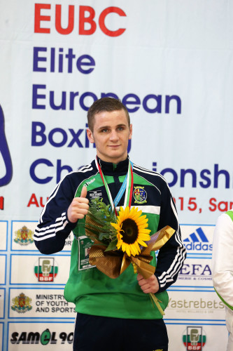 Dean Walsh celebrates with his bronze medal