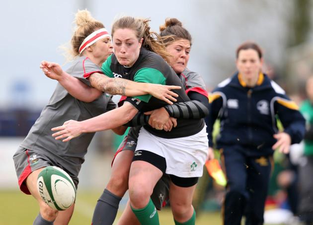 Elise O'Byrne White knocks the ball on