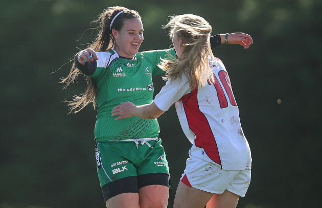 Erin Caughey with Mairead Hopkins at the end of their game