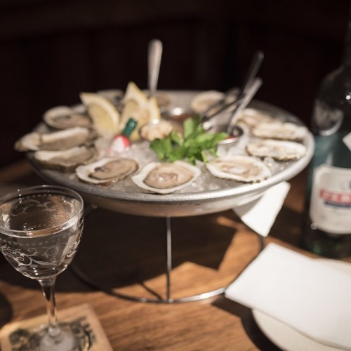 Oysters, Martinis & Absinthe. The Parlor Green Hour runs Monday through Friday from 5pm-7pm with $1 East Coast oysters and specially priced Absinthe laced cocktails.