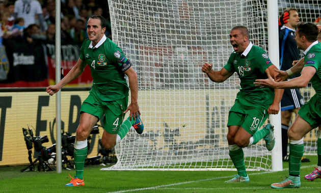 John Oohn O'Shea celebrates scoring the equalising goal