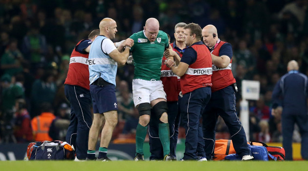 Paul O'Connell tries to get to his feet before being stretchered off the field