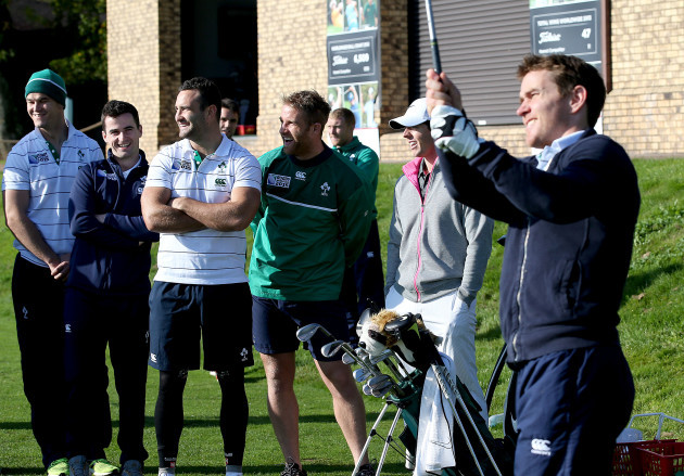 Rory McIlroy with Dave Kearney, Jonathan Sexton and Dan Downey as Eoin Reddan tees off