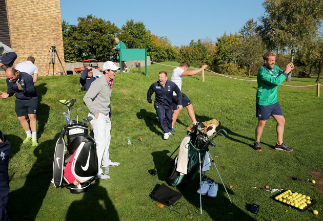 Rory McIlroy shares a joke with the Irish players as Luke Fitzgerald duffs a tee shot