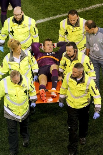 Shay Given is stretchered off as Martin O'Neill has a word with him