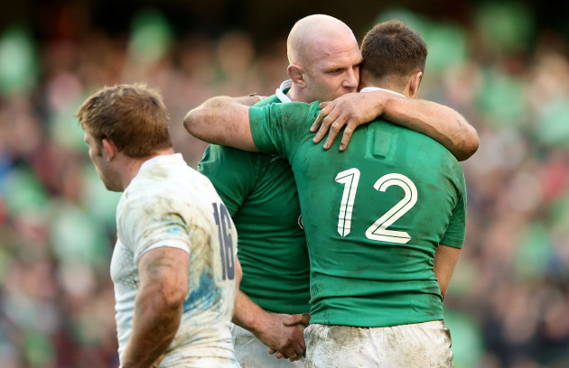 Paul OÕConnell celebrates with Robbie Henshaw after the game
