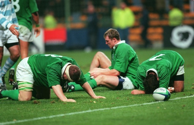 Ireland players dejected as the whistle blows