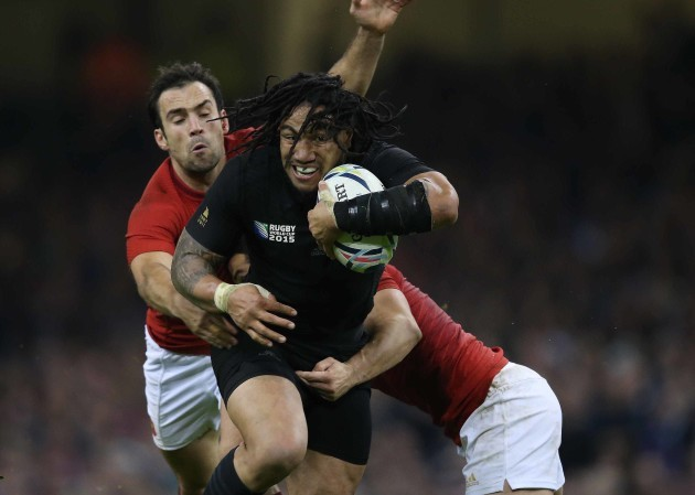 New Zealand's Ma'a Nonu is tackled by France's Morgan Parra
