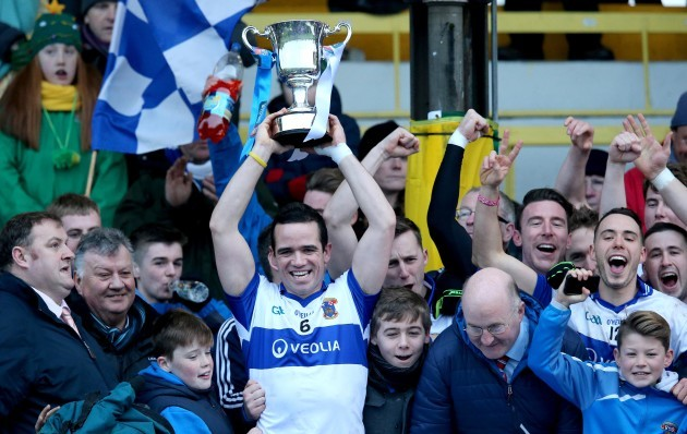 Ger Brennan lifts the trophy