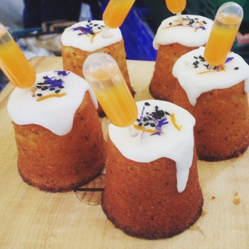Passion fruit cake with a pipette of saffron gin and passion fruit cocktail.