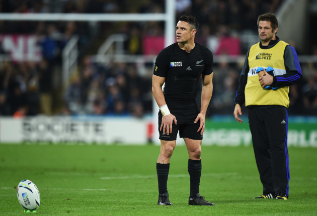 Dan Carter lines up a conversion as Richie McCaw looks on