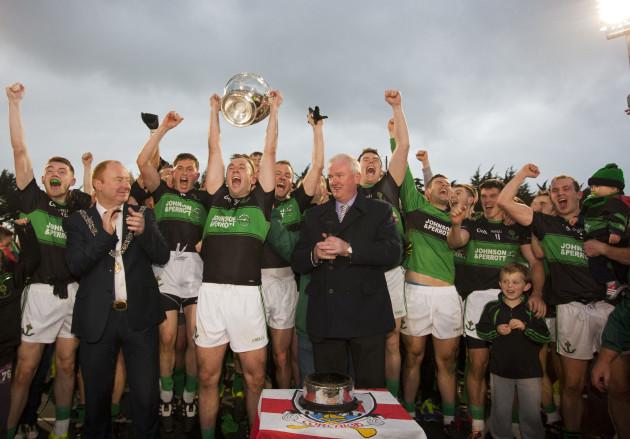 Paul Kerrigan lifts the trophy