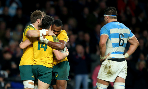 Sean McMahon and Tevita Kuridrani celebrate with Adam Ashley-Cooper after he scored his sides third try